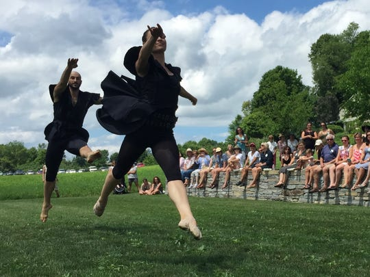 Dancers Chatch Preggers, left and Megan Stearns of Farm to Ballet perform a lightning-bug courtship ritual Sunday at a performance in Hinesburg. The troupe was part of a garden tour fundraiser to benefit the Flynn Center for the Performing Arts in Burlington. Photographed Sunday, July 17, 2016.