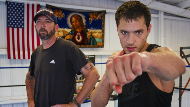 Bryant Perrella, of Lehigh Acres, with trainer Mike Nowling train in South Fort Myers. Perrella, a 26-year-old, 6-foot-1 southpaw welterweight will be fighting on the undercard of the Keith Thurman-Luis Collazo World Boxing Association welterweight title matchon July 11 in Tampa.