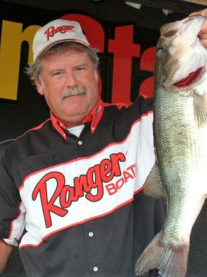Marshall Deakins holds a bass.