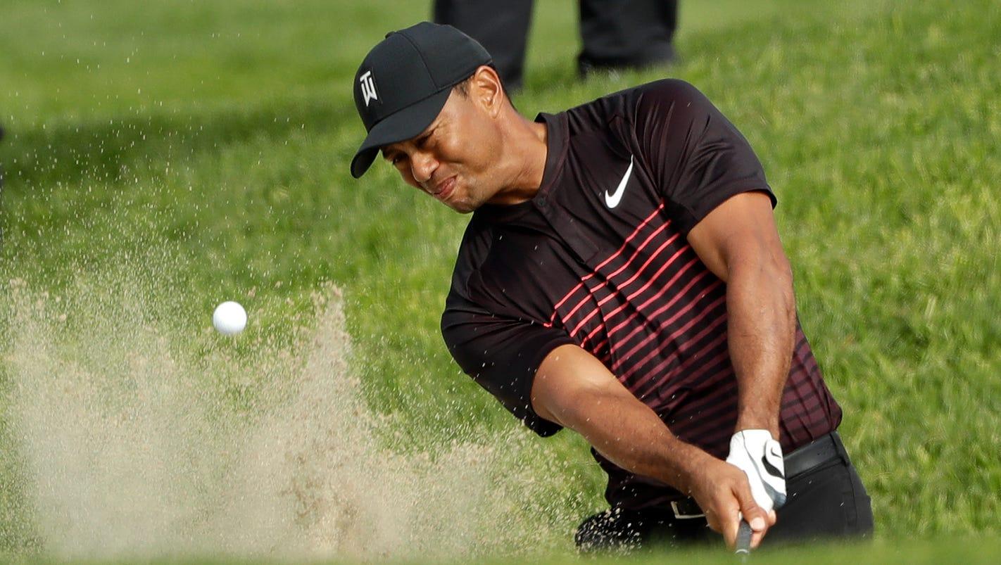 Thursday's golf: Tiger Woods shoots 72 in return