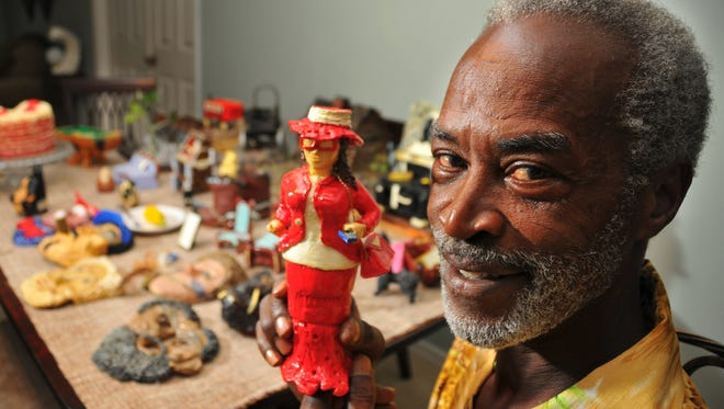 Palm Bay visionary folk artist Murray Stuckey started carving Ivory soap about 14 years ago. Stuckey is shown holding Miss Sassy.