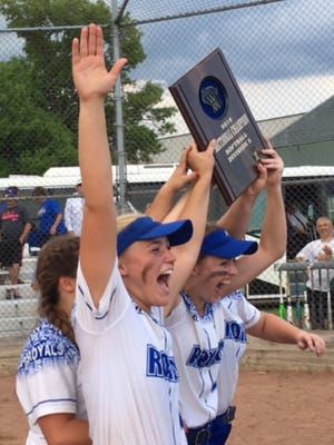 Assumption first baseman Claire Preuss celebrates after she and the other three Royals seniors collected a WIAA Division 5 sectoinal title plaque with a 8-1 win over Wausaukee on Thursday.