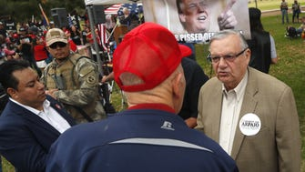 Joe Arpaio talks with potential voters during a Trump rally at Cactus Park on March 10, 2018, in Phoenix. Arpaio, who was ousted duringhis 2016 re-election bid for sheriff and was convicted of contempt of court in connection with a federal racial-profiling case, brought in $500,000 for the first fundraising quarter of the Senate, his team reported. He has $250,000 on hand.