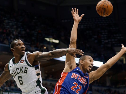 Detroit Pistons' Avery Bradley (22) is blocked by Milwaukee Bucks' Eric Bledsoe (6) during the first half of an NBA basketball game Wednesday, Nov. 15, 2017, in Milwaukee. (AP Photo/Aaron Gash)