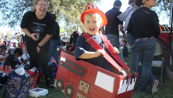 Benjamin Eberts, 3, shows off his firefighting costume during Zoo Boo 2015 at the Alameda Park Zoo on Saturday.