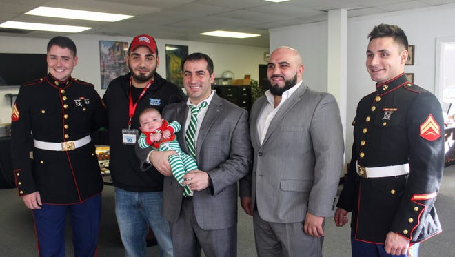 From left to right: Marine Cpl. Kevin Webb of Westland, Samir Ali of Belleville, Kal Hakkani and son Adam Hakkani of Canton, Moe Hakkani of Van Buren Township and Marine Cpl. Hunter Johnson of Garden City. The men were all at the second Grains and Trains event last week.