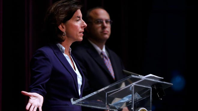 """Gov. Gina Raimondo, flanked by Commerce Secretary Stefan Pryor, cautioned Rhode Islanders on Monday: """"I promise you this: If you stop following the rules, we will have to shut down the economy again."""""""
