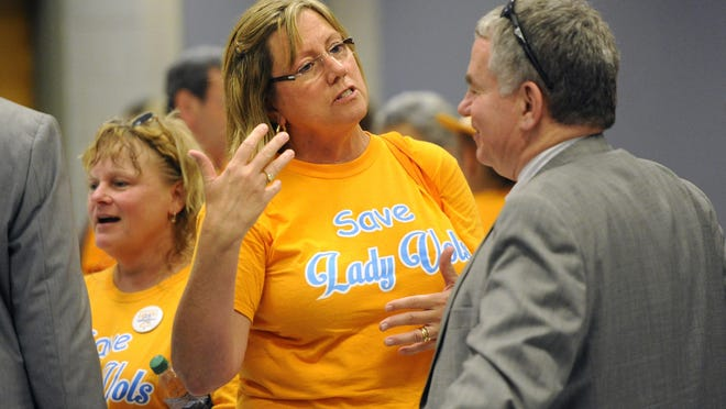 Former Tennessee Lady Vols swimmer Mollie DeLozier, center, talks with James Murphy, University of Tennessee Board of Trustees vice chair, following the board's annual meeting at Hollingsworth Auditorium, Thursday, June 25, 2015, in Knoxville, Tenn. The board did not address the issue of the Lady Vols nickname as the university prepares to eliminate the nickname and logo for all women's sports other than basketball.