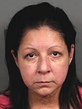 Isabel Bandej is accused of embezzling $100,000 from a La Quinta brokerage firm.