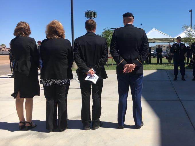 Funeral attendees wait for Army Special Forces personnel