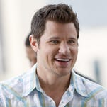 "Singer Nick Lachey smiles while filming a segment for a music video promoting Cincinnati as ""The City that Sings"" at Great American Ball Park in 2012."