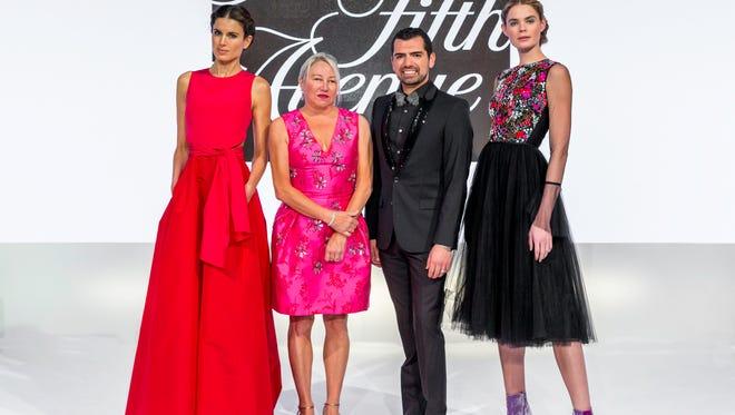 (left to right) Model, Patti Grundhofer, General Manager of Saks Fifth Avenue Palm Desert, Dennis Flaig, model.