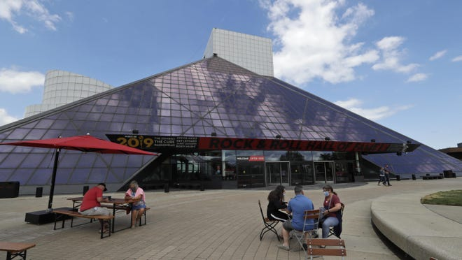 People keep a social distance outside the Rock & Roll Hall of Fame after it reopened June 15, 2020, in Cleveland. The museum has new health and safety precautions in place to protect staff and guests.