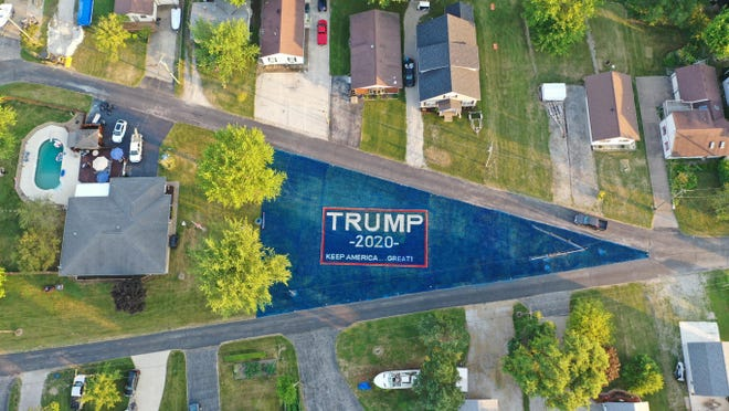 J.R. Majewski used about 120 gallons of biodegradable chalk paint to create a 19,000-square-foot Trump banner in his triangular front yard near Port Clinton. He said he wanted to show his appreciation of Trump's support for the military.