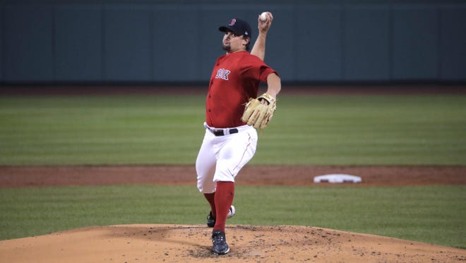 Zack Godley delivers in Wednesday's exhibition against the Blue Jays.