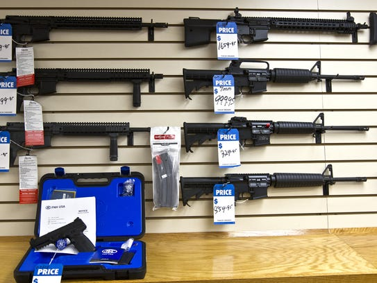 An assortment of AR-15 rifles on display at Fowler Firearms and Gun Range in Fort Myers. Fla.