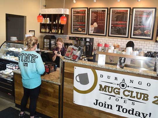 Mikayla Krens takes an order on Friday at Durango Joes Coffee in the Farmington Plaza.