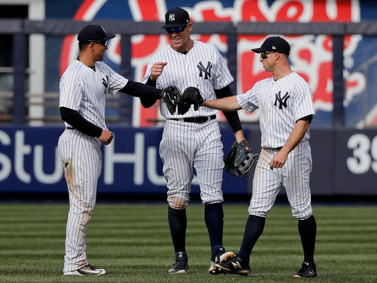 New York Yankees outfielders, from left, Jace Peterson,