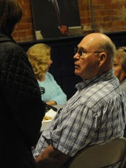 Harry Hiles talks to people Tuesday night, Nov. 7,