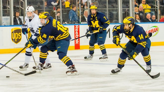 (From left) Kyle Connor, JT Compher  and Tyler Motte from a game against Penn State.