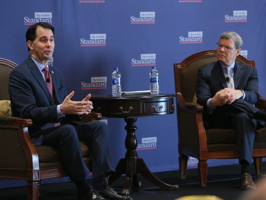 Gov. Scott Walker takes part in a program at the Pfister Hotel, hosted by the Weekly Standard, called the Midwest Conservative Summit. Former Milwaukee radio host Charlie Sykes (right) moderated the discussion between guests and the audience.