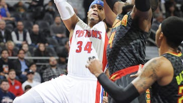 Tobias Harris scores over the Hawks' Paul Millsap in the first quarter.