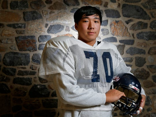 Tianqi Dai (70), a native of China, took up football only two years ago. Now he's starting on the defensive line for undefeated Wilmington Friends.