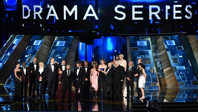 The cast of  'Game of Thrones' accepts outstanding drama series during the 67th Emmy Awards.