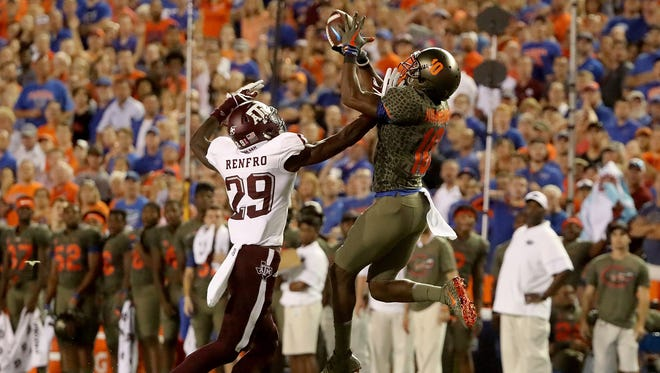 Florida's Josh Hammond goes up for a catch against Texas A&M's Debione Renfro during Saturday's game in Gainesville.