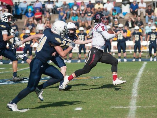 Cheatham County quarterback Landon Barnes runs in the
