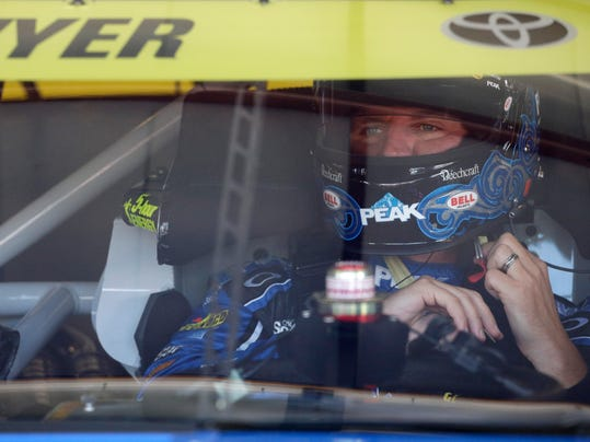Clint Bowyer gets ready for practice for the NASCAR Sprint Cup Series auto race at Chicagoland Speedway, Saturday, Sept. 19, 2015, in Joliet, Ill. (AP Photo/Nam Y. Huh)