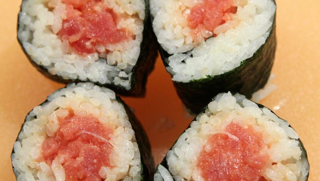 Sushi rolls wrapped in nori. Make sushi at the Public Market during August.