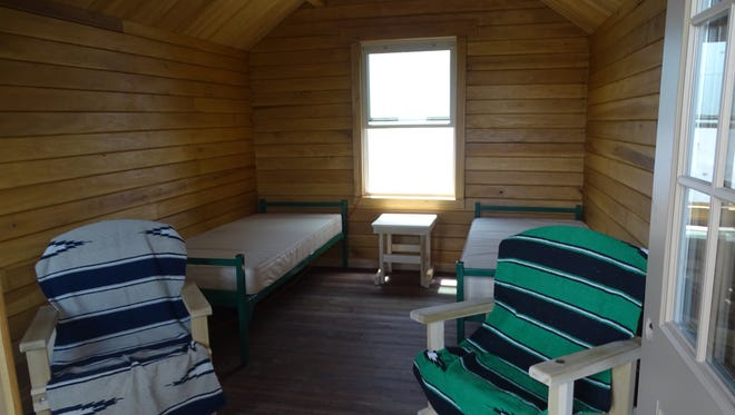 The one-room Camp Sherman cabins will have electricity,a  mini-refrigerator, heating, and cooling. The cabins and furniture - including the mattresses - are entirely constructed by inmates.