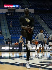 Tacko Fall warms up before the start of the game against