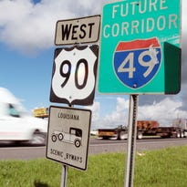 """Leslie Westbrook, The Advertiser  A """"Future Corridor of I-49"""" sign is displayed among others as traffic moves north along Hwy. 90 in Broussard. A """"Futrure Corridor of I-49"""" sign is displayed among others as traffic moves north along Hwy. 90 in Broussard, La. Wednesday, September 10, 2014."""