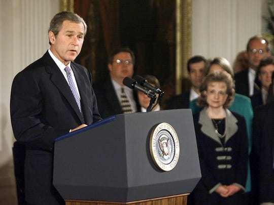 President Bush speaks to newly sworn-in White House staff members in an East Room ceremony on Jan. 22, 2001.