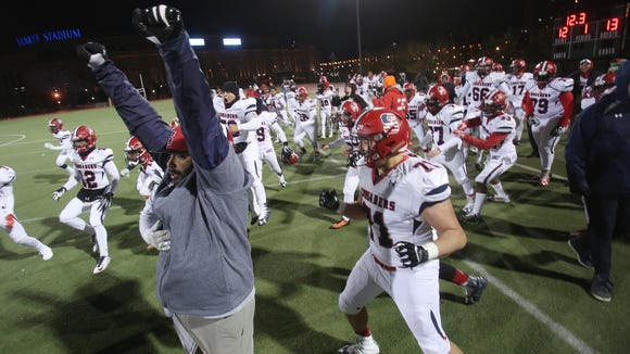 Stepinac celebrates their 13-12 victory over  Cardinal