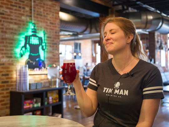 Sara Davidson of Tin Man Brewing Co. and member of the Pink Boots Society takes the first sip of Akala IPA. Pink Boots Society Indianapolis took part in the international collaboration day and brewed up Akala IPA at Sun King Brewery.