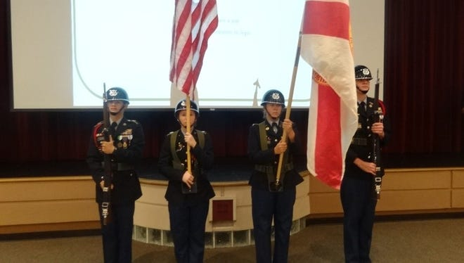 From left to right Cadet Sgt. Maj. Adam Pagan (from left), Cadet Command Sgt. Maj. Jamie Triplett, Cadet Maj. Catherine Zukowski and Cadet Maj. Julian Taft participate in the Sept. 11 ceremony at Port St. Lucie High School.