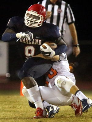 Oakland's Ty Nix (9)is brought down by Blackman's Blake Taylor (10) at Oakland, on Friday Sept. 18, 2015.