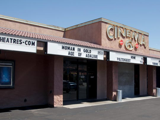 """The movie theater on the south end of Main Street had just three screens in February of 1988 when the then image was taken by Spectrum photographer Nancy Rhodes. Holly Hunter's film """"Broadcast News,"""" Robin Williams' film """"Good Morning Vietnam"""" and Cher's film """"Moonstruck"""" were playing at the theater at the time. The building has since been remodeled and expanded with stadium style seating added and in the now image, taken by Spectrum photographer Jud Burkett, eight different films are listed the marquees as now playing at the theater."""