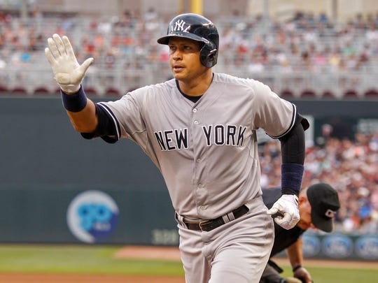 Alex Rodriguez celebrates after hitting his first of three home runs against the Minnesota Twins on Saturday.