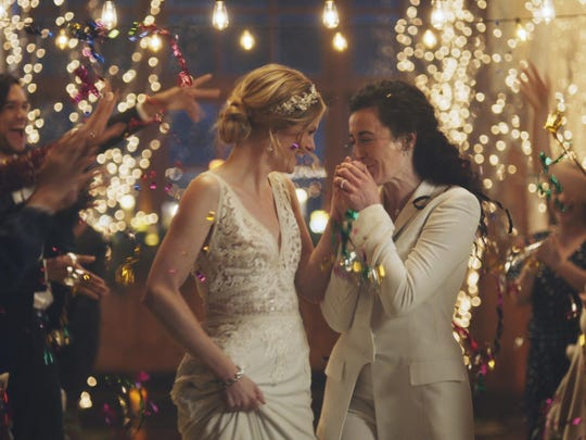 This image made from undated video provided by Zola shows a scene of its advertisement that was pulled from The Hallmark Channel. The Hallmark Channel says it will reinstate the same-sex marriage commercials.