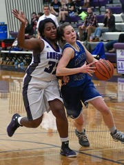 Harper Creek's Faith Hayes (21) drives past Lakeview's