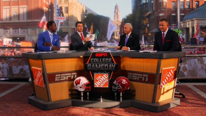 ESPN's College GameDay crew incorporated point spreads in their picks on Saturday during their broadcast from Sundance Square in Fort Worth.
