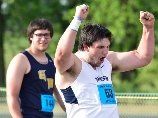 Kelton Chastulik of Chambersburg celebrates after winning the shot with a throw of 61-10.5. Greencastle's Campbell Parker is in the background. PIAA District 3 Track & Field events are being held Friday, May 19 - 20 at Shippensburg University.