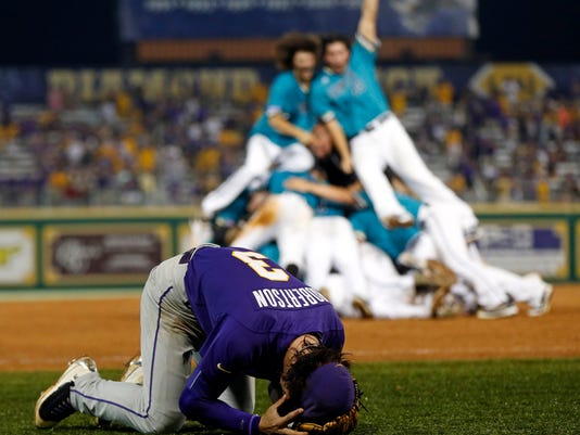LSU shortstop Kramer Robertson (3) reacts as Coastal Carolina celebrates after LSU lost in the bottom if the ninth inning of an NCAA college baseball tournament super regional game in Baton Rouge, La., Sunday, June 12, 2016. Coastal Carolina  advanced to the College World Series. (AP Photo/Gerald Herbert)