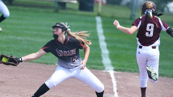 Valley first baseman Lexi Merritt (23) catches the late throw as Ankeny's Olivia Brooks (9) runs through safe at first on Monday, July 20, 2015, during the Class 5-A quarterfinals.