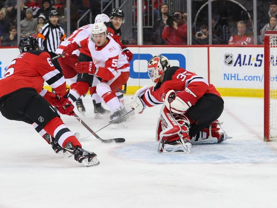 New Jersey Devils goalie Cory Schneider (35) makes a save during the first period of their game against the Detroit Red Wings at Prudential Center.