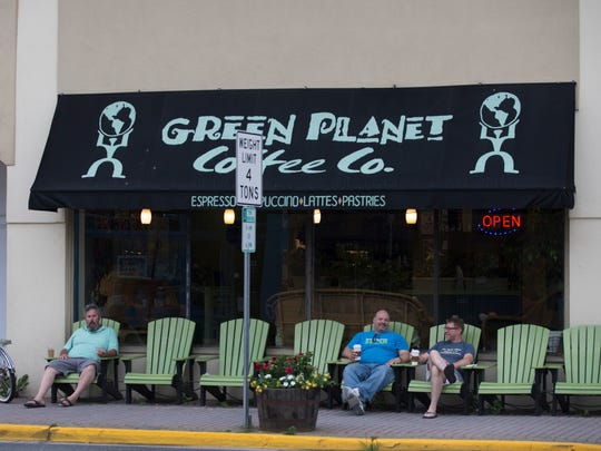 Point Pleasant Beach locals Mike Tamburro and John Durante enjoy their morning coffee and conversation in front of the Green Planet Coffee Company at the corner of Bay and Arnold Aves.